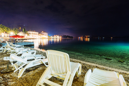 Sunbeds on a beach at night Stock Photo