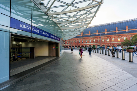 LONDON, UNITED KINGDOM - OCTOBER 31: This is one of the main entrances to Kings Cross St Pancras underground station with Kings Cross international station in the distance on October 31, 2016 in London