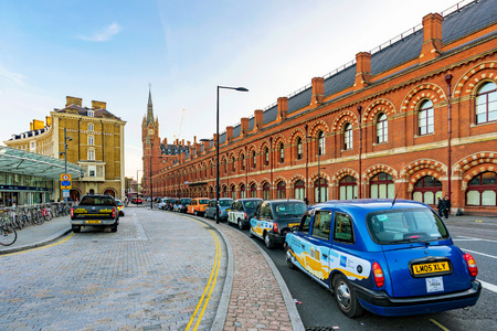 LONDON, UNITED KINGDOM - OCTOBER 31: This is a taxi rank outside Kings Cross St Pancrass station where taxis wait for travelers coming from the train station on October 31, 2016 in London Editorial
