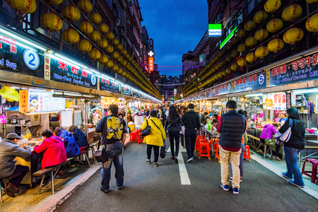 KEELUNG, TAIWAN - NOVEMBER 28: This is Keeelung night market a famous night market where people go to eat in Keelung city near Taipei on November 28, 2016 in Keelung Stock Photo - 71874729