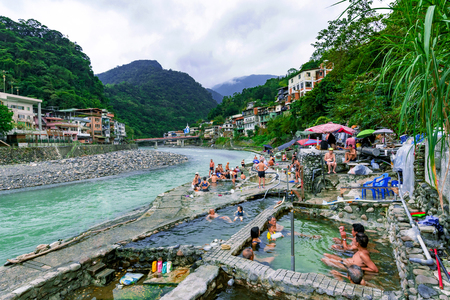 a bathing place: TAIPEI, TAIWAN - NOVEMBER 29: This is is a view of public hot spring baths in Wulai village on November 29, 2016 in Taipei Editorial