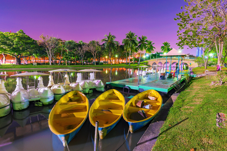 Boats in the lake in Chatuchak park at night Stock Photo