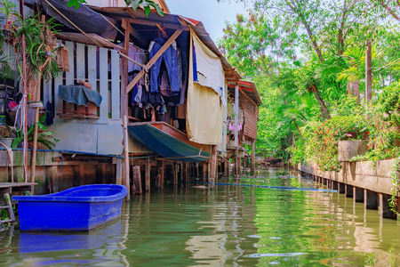 townhouses: Riverside canal houses in countryside of Thailand