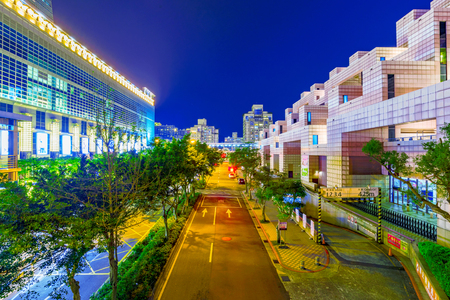 TaIPEI, TAIWAN - FEBRUARY 16: This is a downtown road in Xinyi financial district with Taipei 101 mall on the left and the World trade center on the right both of which are famous landmarks on Februrary 16, 2017 in Taipei