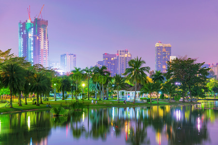 Night view of Chatuchak park lake and architecture