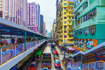 HONG KONG, CHINA - APRIL 24: This is a View of architecture and a road with traffic in the busy area of Mong Kok  on April 24, 2017 in Hong Kong