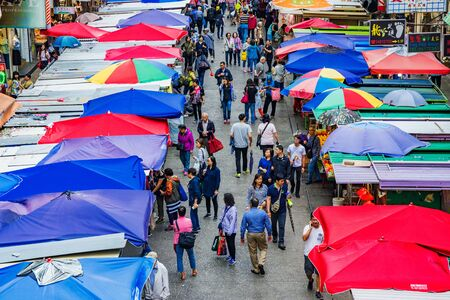 local 27: HONG KONG, CHINA - APRIL 27: This is an aerial view of Fa Yuen street market a busy local street market which is also popular with tourists on April 27, 2017 in Hong Kong