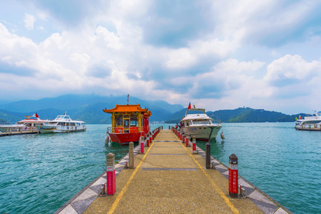 NANTOU, TAIWAN - MAY 06: This is a pier on Sun Moon Lake with tour boats which tourists use to visit different sights on the lake on May 06, 2017 in Nantou