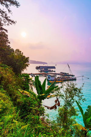 famous industries: Scenic view of Sun Moon Lake with sunset and rafts Stock Photo