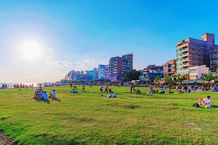 come in: TAIPEI, TAIWAN - MAY 29: View of Tamsui riverside park area where people come to sit relax and have picnic in the summer time and look at the river views on May 29, 2017 in Taipei Editorial