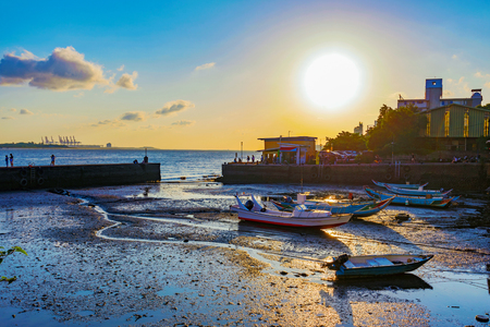 Sunset with docks and sea in Tamsui Taipei 版權商用圖片