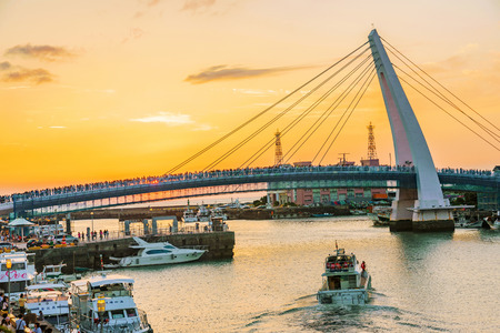 TAIPEI, TAIWAN - MAY 29: This is a view of lovers bridge in fishermans wharf, it is a famous bridge where couples come to view the sunset in the Tamsui area on May 29, 2017 in Taipei Editorial