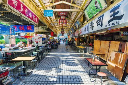 TAIPEI, TAIWAN - JUNE 07: This is the Huaxi street market which is a popular night market in Taipei where many people come to try different foods and go shopping on June 07, 2017 in Taipei Editorial
