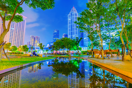 TAIPEI, TAIWAN - JUNE 08: This is a park in Banqiao near Citizen square where you can see many office buildings and skyscrapers on June 08, 2017 in Taipei