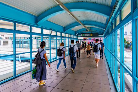 TAIPEI, TAIWAN - JUNE 09: This is an overpass bridge which passenger use to transfer to the other line in Zhongxiao fuxing MRT station a busy station in the downtown area on June 09, 2017 in Taipei Stock Photo - 81982359