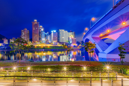 where to go: TAIPEI, TAIWAN - JUNE 22: This is a night view of Bitan riverside park in the Xindian district. The park is a popular travel destination where people go to see scenic views of the area on June 22, 2017 in Taipei Editorial