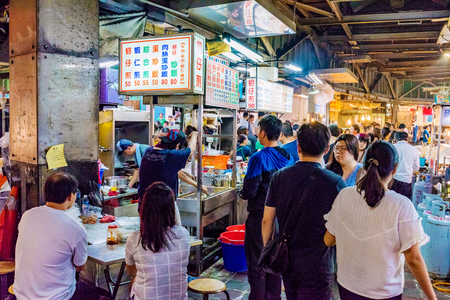 TAIPEI, TAIWAN - JULY 02: This is a night scene of Jingmei night market where many local Taiwanese people come at night to eat various types of Taiwanese food on July 02, 2017 in Taipei Editorial