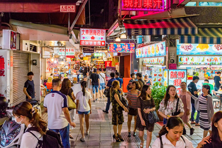 TAIPEI, TAIWAN - JULY 11: This is Shilin night market a famous night market where many people come to try Taiwanese food and go shopping on July 11, 2017 in Taipei Editorial