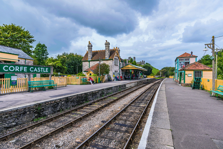 CORFE, UNITED KINGDOM - SEPTEMBER 06: This is Corfe Castle railway station. Corfe is a small medieval village with old traditional British architecture on September 06, in Corfe