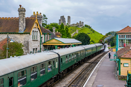 CORFE, UNITED KINGDOM - SEPTEMBER 06: This is a view of Corfe Castle railway station with an old steam train passing through on September 06, in Corfe