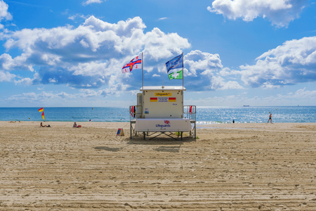 BOURNEMOUTH, UNITED KINGDOM - SEPTEMBER 08: Scenic view of Bournemouth beach with a lifegaurd hut on a sunny day on September 08, 2017 in Bournemouth