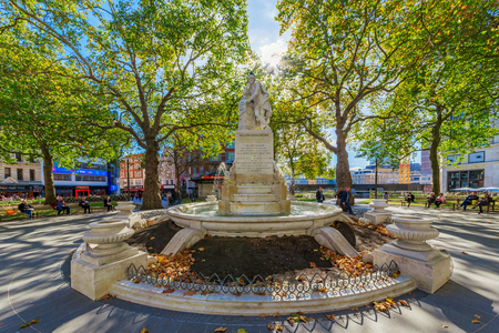 LONDON, UNITED KINGDOM - OCTOBER 06: This is the famous William Shakespeare statue in Leicester Square, it is a popular landmark and tourist destination on October 06, 2017 in London