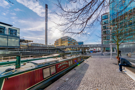 LONDON, UNITED KINGDOM - OCTOBER 30: This is a view of Paddington Basin boats and riverside architecture on October 30, 2017 in London