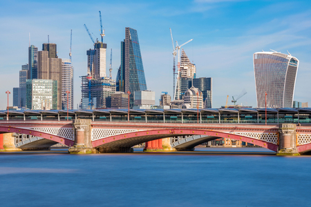 City of London financial district skyline along the River Thames Stock Photo