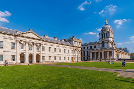 LONDON, UNITED KINGDOM - APRIL 20: View of the Old Royal Naval College, a popular travel destination and Unesco World Heritage site on April 20, 2018 in London