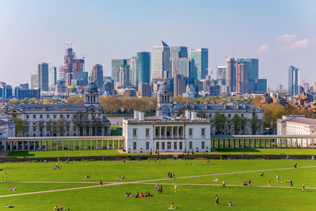 LONDON, UNITED KINGDOM - APRIL 20: View of Greenwich Maritime museum and  London skyline from Greenwwich park on April 20, 2018 in London