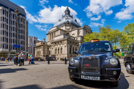 LONDON, UNITED KINGDOM - MAY 04: Typical London Taxi waiting outside Westminster Abbey for passengers on May 04, 2018 in London