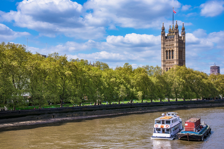 View of Westminster Palace along the River Thames in London, UK