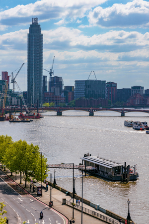 LONDON, UNITED KINGDOM - MAY 04: View of the Vauxhall tower and city buildings along the River Thames on May 04, 2018 in London