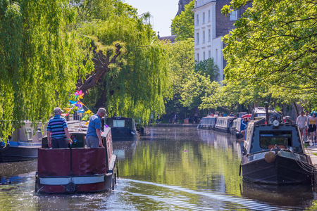 LONDON, UNITED KINGDOM - MAY 05: Scenic view of a boats on the Regents Canal in Camden, a famous canal which runs through the city May 05, 2018 in London