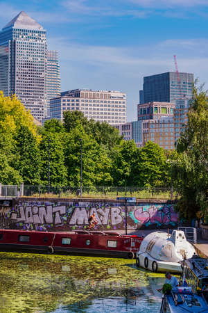 LONDON, UNITED KINGDOM - JUNE 06: View of Canary Wharf financial district architecture taken from Limehouse Cut on June 06, 2018 in London