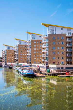 LONDON, UNITED KINGDOM - JUNE 06: This is a view of waterfront apartment buildings in Limehouse Basin, a famous marina along the Regents Canal on June 06, 2018 in London
