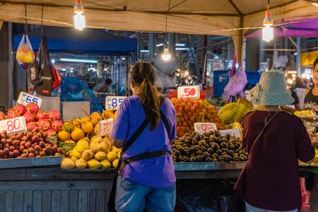 PATTAYA, THAILAND - JULY 07: Traditional Thai fruit stalls selling exotic fruit at Thepprasit Road night market on July 07, 2018 in Pattaya