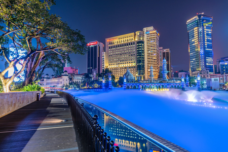 KUALA LUMPUR, MALAYSIA - JULY 20: Night view of city buildings in the mist along the River of Life in the downtown area on July 20, 2018 in Kuala Lumpur