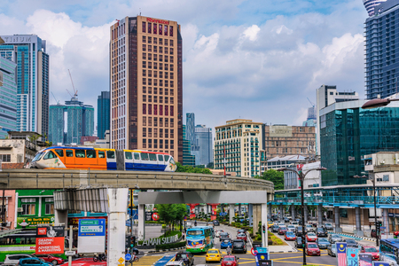 KUALA LUMPUR, MALAYSIA - JULY 22: City view of buildings and Monorail in the downtown area on July 22, 2018 in Kuala Lumpur Editorial