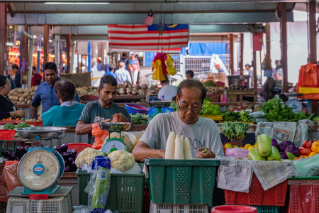 KUALA LUMPUR, MALAYSIA - JULY 22: Fruit stall and vegetables stalls selling fresh local produce in the famous Chow Kit market on July 22, 2018 in Kuala Lumpur