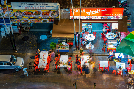 KUALA LUMPUR, MALAYSIA - JULY 24: Aerial view of Jalan Alor food street vendors, a famous food street where many tourists come to eat at night on July 24, 2018 in Kuala Lumpur Editoriali