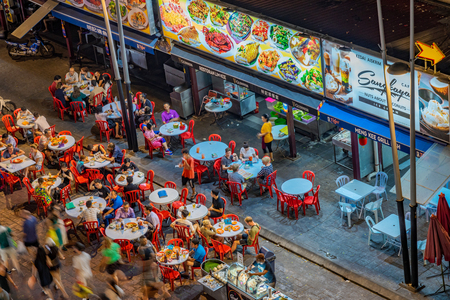 KUALA LUMPUR, MALAYSIA - JULY 24: Aerial view of Jalan Alor food street vendors, a famous food street where many tourists come to eat at night on July 24, 2018 in Kuala Lumpur Editorial