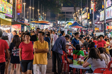 KUALA LUMPUR, MALAYSIA - JULY 24: Crowds of people in Jalan Alor food street, a famous street where many people come to eat at night on July 24, 2018 in Kuala Lumpur