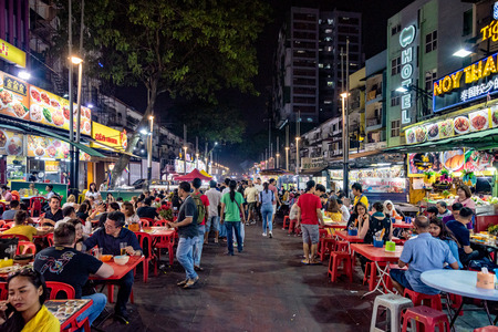 KUALA LUMPUR, MALAYSIA - JULY 24: View of Jalan Alor food street, a famous street with many restaurants and food vendors on July 24, 2018 in Kuala Lumpur
