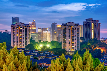 KUALA LUMPUR, MALAYSIA - JULY 28: This is a night view of high rise apartment buildings near the downtown area on July 28, 2018 in Kuala Lumpur