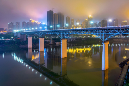 Jialingjiang bridge and high rise city buildings at night in Chongqing Reklamní fotografie