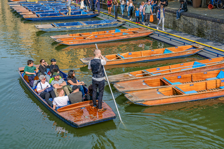 CAMBRIDGE, UNITED KINGDOM - APRIL 18: View of a traditional Punt boat giving a tour along the River Cam on April 18, 2019