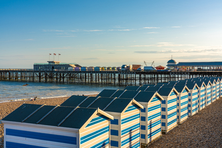HASTINGS, UNITED KINGDOM - JULY 29: Beach huts on Hastings beach near the pier in the summer time on July 29, 2019 in Hastings