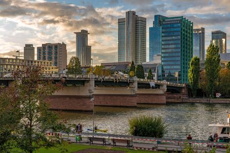 FRANKFURT, GERMANY - SEPTEMBER 25: View of the riverside park area and downtown financial district buildings along the River Main on September 25, 2019 in Frankfurt