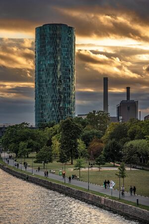 FRANKFURT, GERMANY - SEPTEMBER 25: This is view of the Westhafen Tower building during sunset along the river main on September 25, 2019 in Frankfurt 에디토리얼